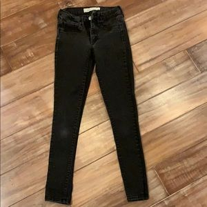 Super skinny black faded denim
